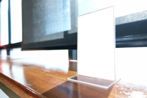 Mock Up Menu Frame Standing On Wood Table In Bar Restaurant Cafe - Standing cafe table
