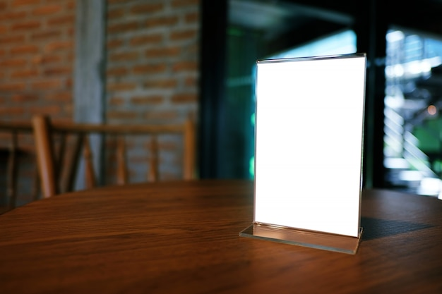 Mock up Menu frame standing on wood table in Bar restaurant cafe ...
