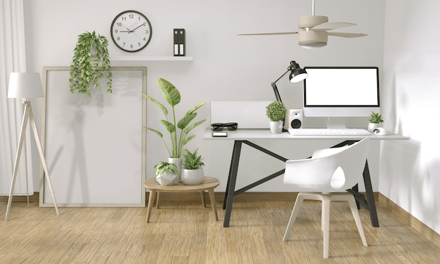 Mock up poster computer in office zen style and decoration on top table office Premium Photo