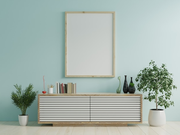 Mock up poster frame on cabinet in interior/blue wall. Premium Photo