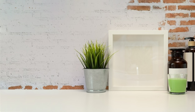 Mock up poster frame on wood table Premium Photo