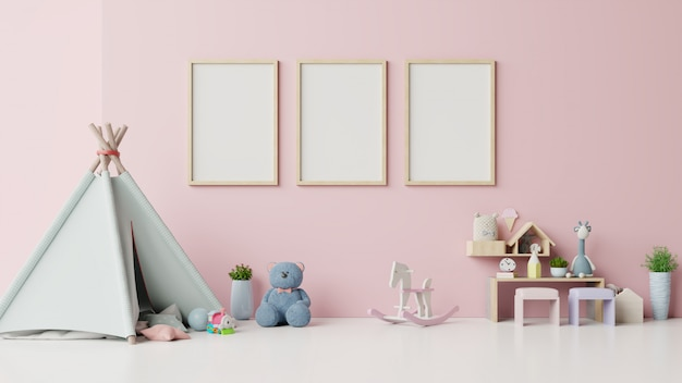 Mock up posters in child room interior on pink background. Premium Photo