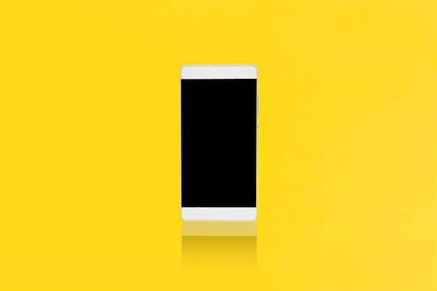 Mock up smart-phone on a yellow background, design for advertising Premium Photo