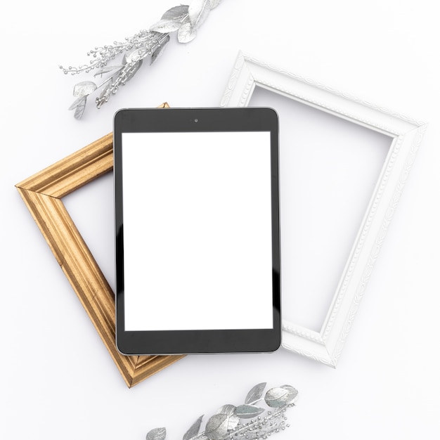 Mock-up tablet on top of frames Free Photo