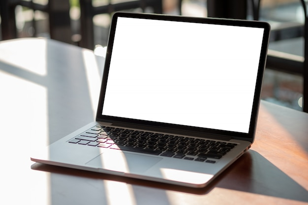 Mock up using laptop with blank screen computer modern Premium Photo