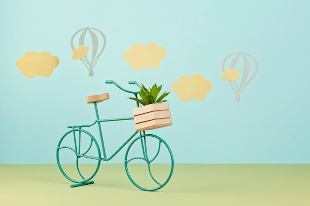 Mock up with paper clouds and flying balloons over the blue pastel background and  toy bicycle Premium Photo
