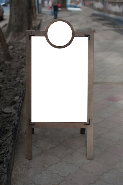 Mock up of wooden outdoor advertising stand.  place for text, poster or public information. Premium Photo