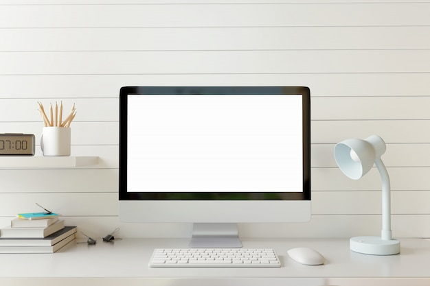 Mock up work space computer with blank screen on white table. Premium Photo