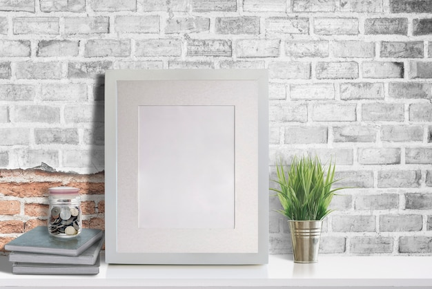 Mockup blank wooden picture frame on white table Premium Photo
