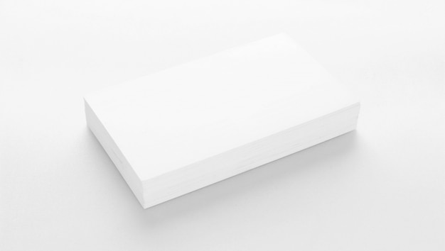 Mockup of business cards on white textured paper background Premium Photo