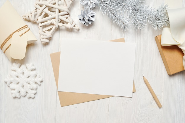 Mockup christmas greeting card letter in envelope with white tree Premium Photo