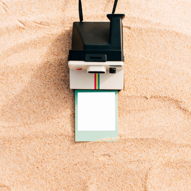 Mockup of an instant photo with camera Free Photo