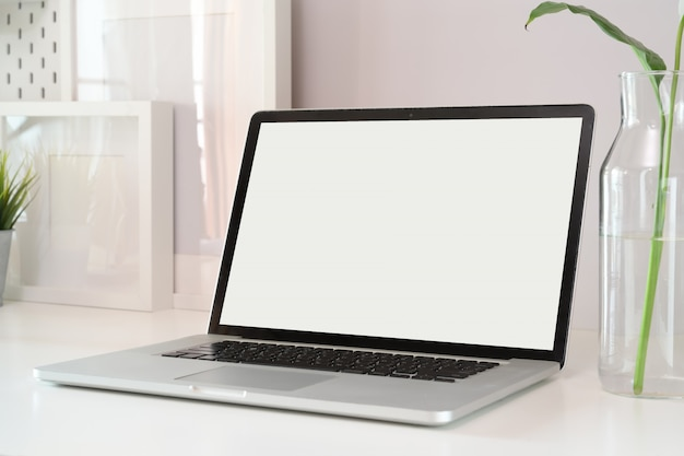 Mockup laptop on white wood workspace. Premium Photo