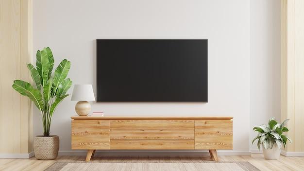 Mockup di una tv montata a parete in un soggiorno con un muro bianco rendering 3d Foto Gratuite