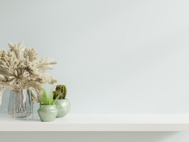 木製の棚の上の植物のモックアップ壁。 無料写真