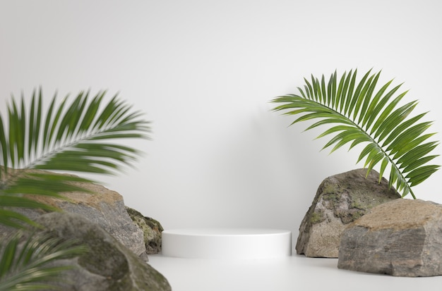 Mockup white podium with rock and palm leave background 3d render Premium Photo