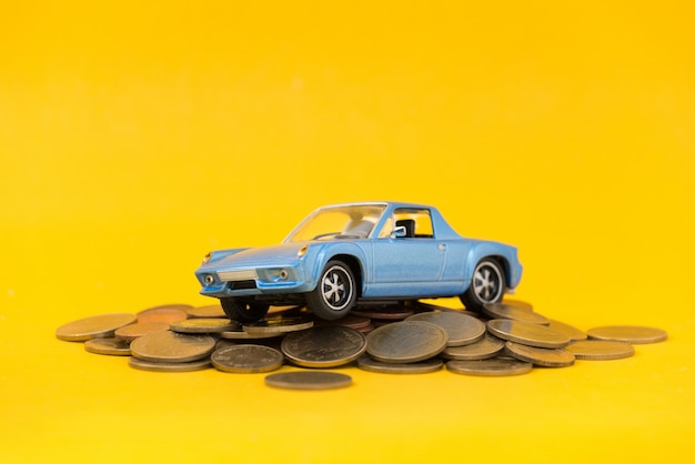 Model blue car park on stack golden coins Premium Photo