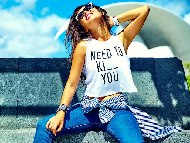 Model in summer  hipster clothes posing in the street Free Photo
