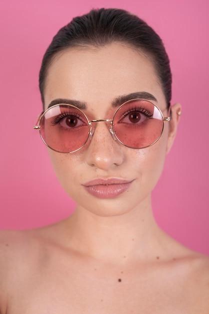Model wearing cute glasses Free Photo