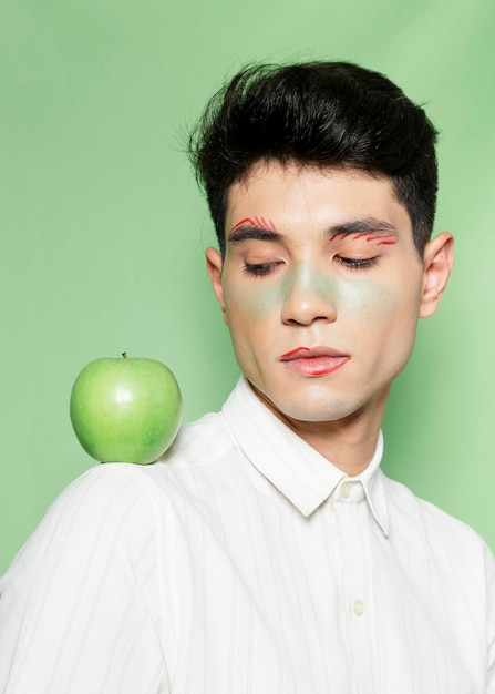 Model with apple on shoulder Free Photo