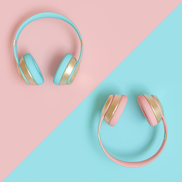 Modern audio headphones in gold, pink and blue on a flat lay bicolor paper Premium Photo