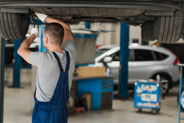 Modern automobile mechanic composition Free Photo