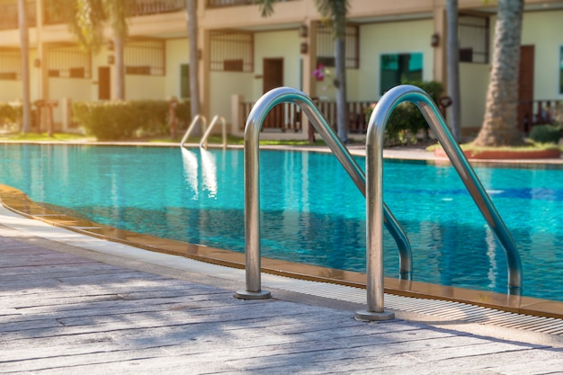 Modern backyard of a swimming pool in public resort or clubhouse Premium Photo