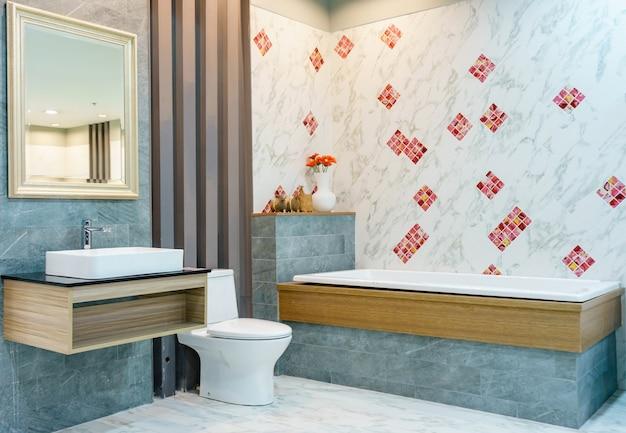 Modern bathroom interior with minimalistic shower and lighting, white toilet, sink and bathtub Premium Photo