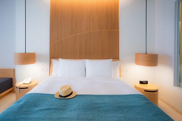 Modern bedroom. beautiful interior of hotel, apartment with double bed Premium Photo