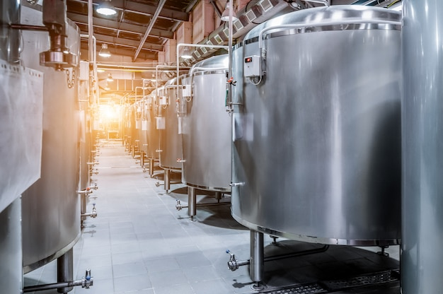 Modern beer factory. small steel tanks for fermentation of beer. Premium Photo