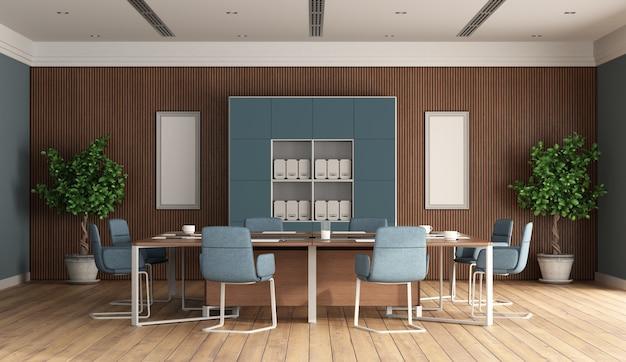 青い家具と背景に木製パネルのモダンな会議室 Premium写真