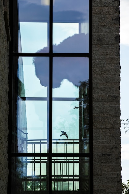 Modern brick building with large window Free Photo