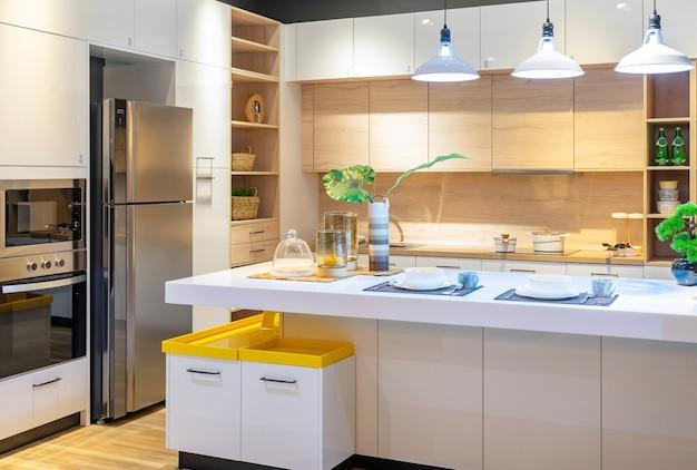 Modern, bright, clean kitchen interior with stainless steel appliances in a luxury apartment. Premium Photo