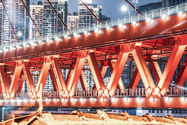 Modern building bridge structure and urban nightscape Premium Photo