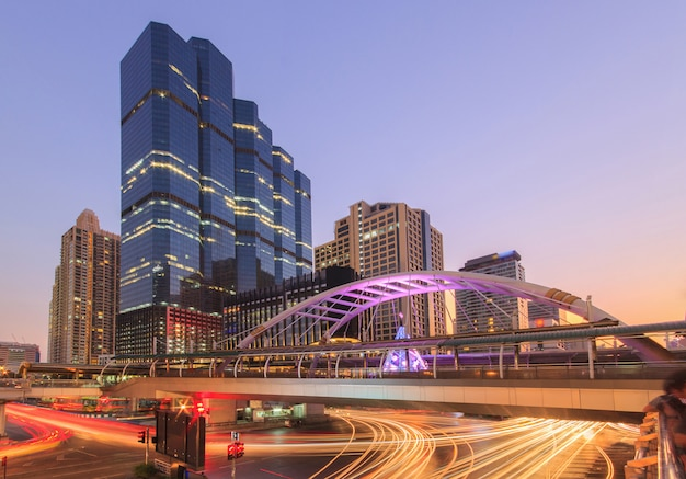Modern building at night. traffic in the business district the skytrain station chong nonsi Premium Photo