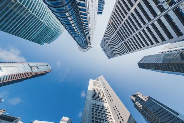 Modern buildings on blue sky at downtown in singapore. Premium Photo