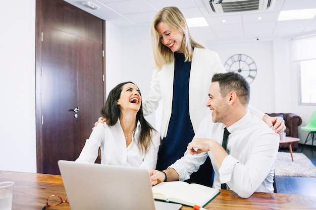 Modern business people laughing 23 2147704579