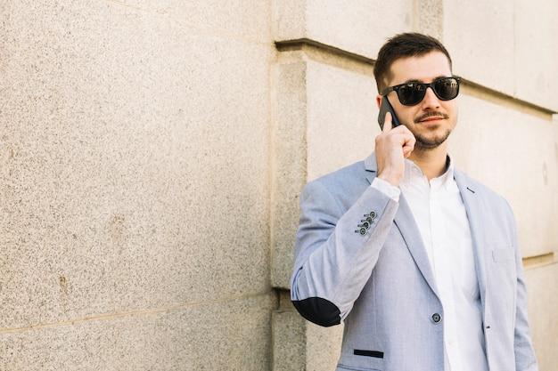Modern businessman making phone call outdoors Free Photo
