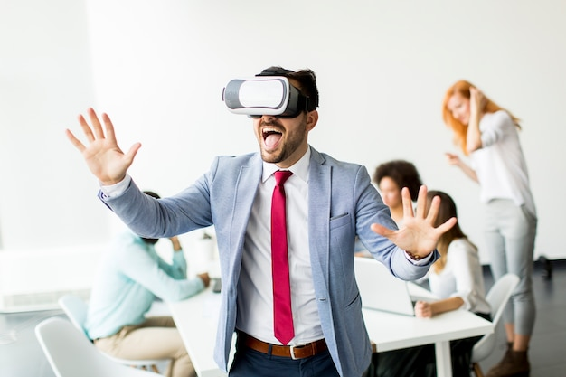 Modern businessman with virtual reality headsets in the office Premium Photo