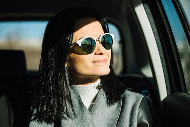 Modern businesswoman sitting in car Free Photo