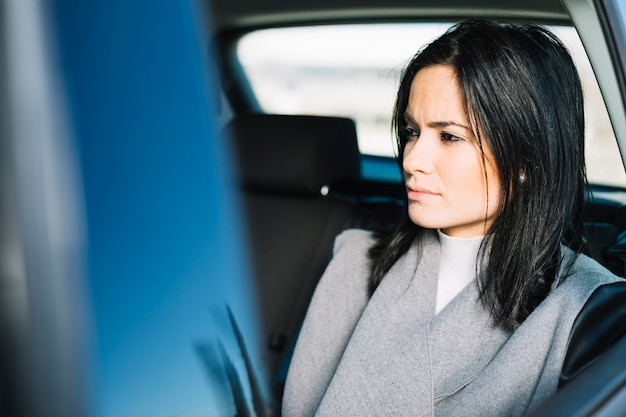 Modern businesswoman sitting in car Free Photo