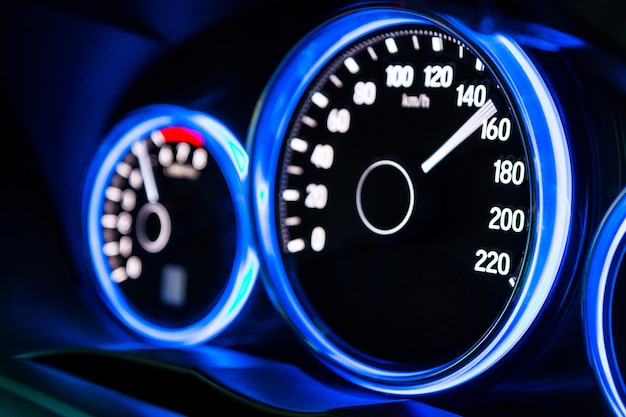 Modern car instrument panel dashboard with blue illuminated display, rev up. Premium Photo
