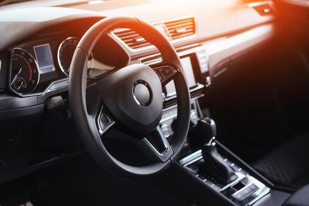 Modern car interior dashboard and steering wheel Premium Photo