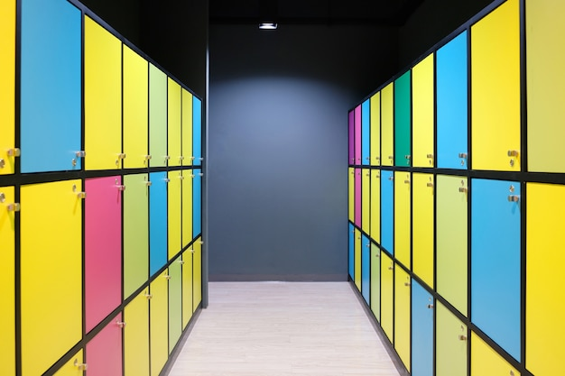 Modern colorful lockers with lighting, multi-color cabinets, public domain. Premium Photo