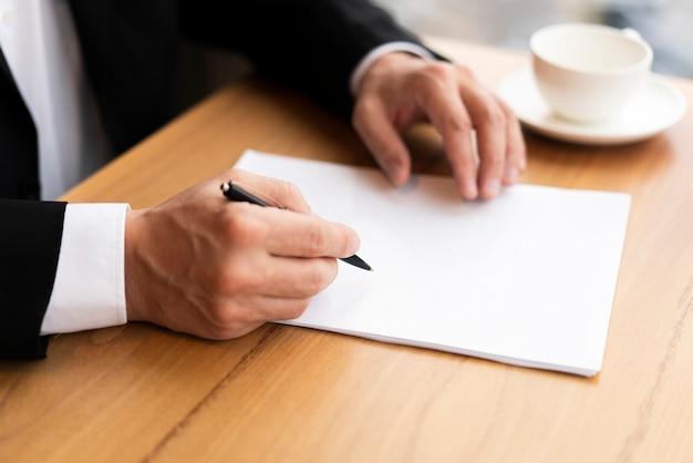 Modern corporate man taking notes Free Photo