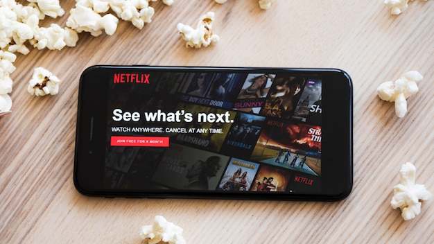 Modern device with netflix app Free Photo