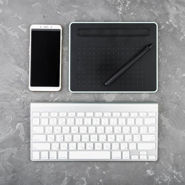 Modern digital devices on slate background Free Photo