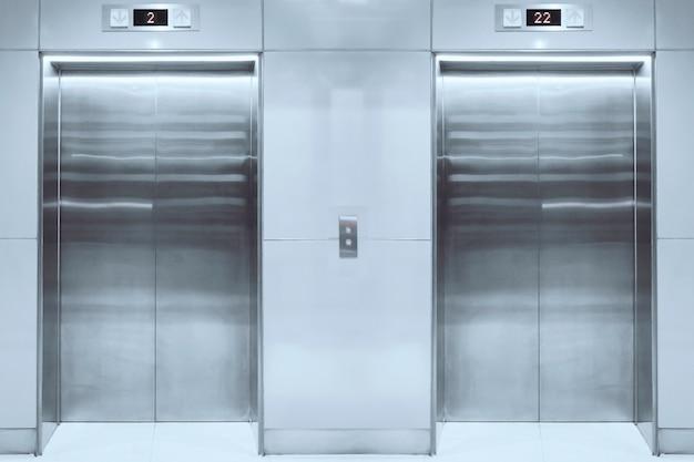 Modern elevator with closed doors in lobby Premium Photo
