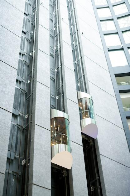 Modern elevators in office lobby Premium Photo