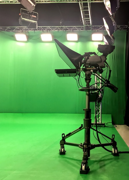 Modern empty green video recording and broadcasting studio